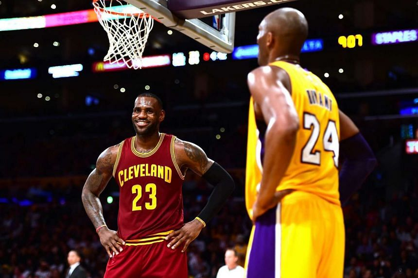 LeBron James #23 of the Cleveland Cavaliers jokes with Kobe Bryant #24 of the Los Angeles Lakers during a 120-108 Cavaliers win at Staples Center on March 10, 2016.