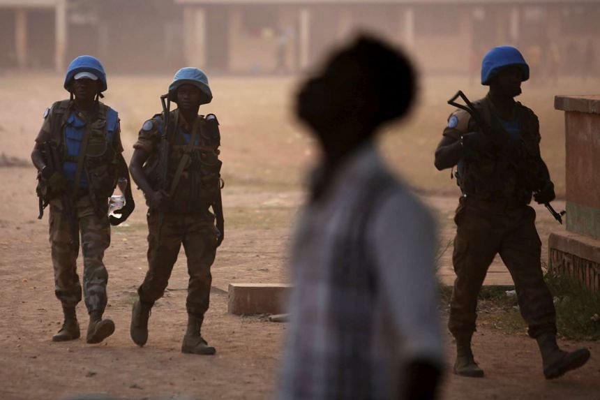 UN peacekeeping soldiers guarding the compound of a school used as an electoral centre at the end of the presidential and legislative elections in Bangui, Central African Republic, on Feb 14, 2016.
