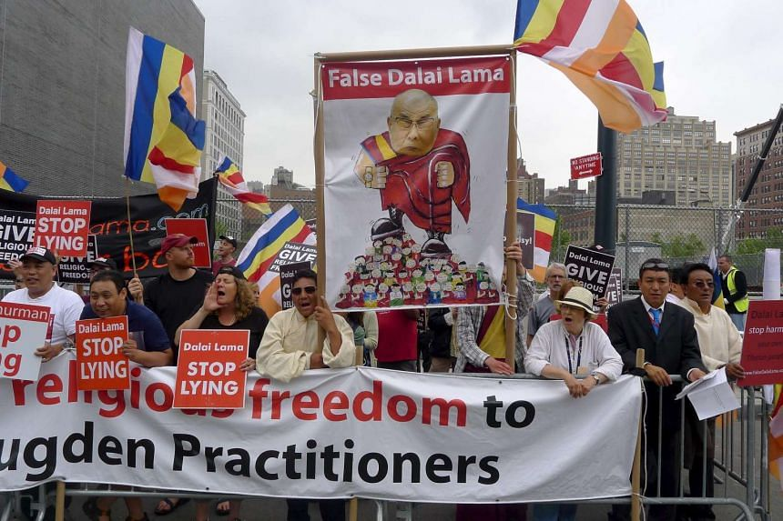 Practitioners of the Dorje Shugden movement protesting against the Dalai Lama outside the Javits Centre in New York on July 9, 2015.