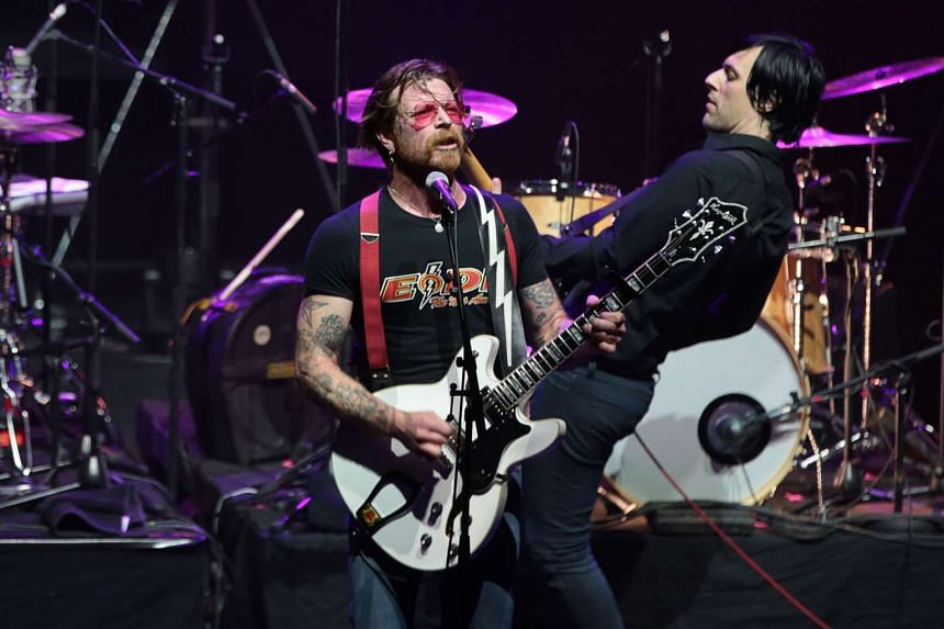 Jesse Hughes (left), the singer of US rock group Eagles of Death Metal, performing on stage at the Olympia concert hall, on Feb 16, 2016.