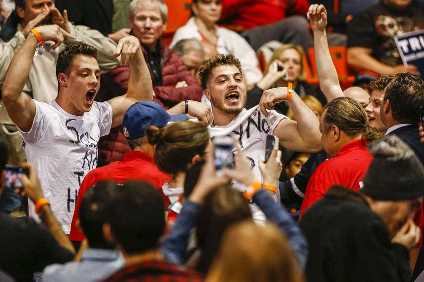 Anti-Trump protestors shouting inside the University of Illinois at Chicago Pavilion before the start of the Republican presidential candidate's rally on March 11.