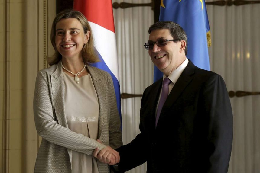 Mogherini (left) shakes hands with Cuba's Foreign Minister Bruno Rodriguez Parrilla in Havana, March 11, 2016.