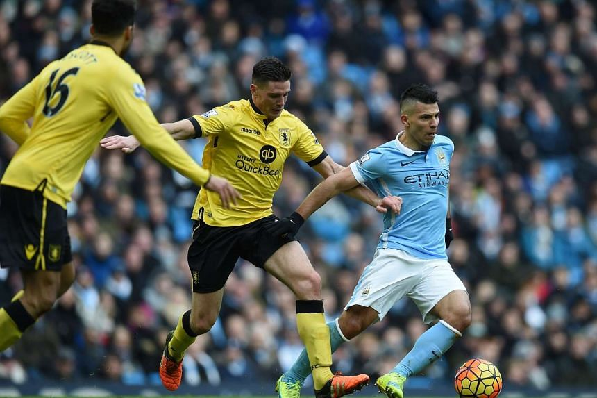 Manchester City's Argentinian striker Sergio Aguero (right) vying with Aston Villa's English-born Irish defender Ciaran Clark (centre) and Aston Villa's English defender Joleon Lescott during the English Premier League football match between Manchest