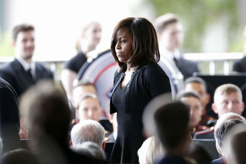 First lady Michelle Obama arrives for the funeral of Nancy Reagan.