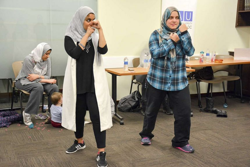 Egyptian-American community activist Rana Abdelhamid (left) demonstrating a move during a self-defence workshop designed for Muslim women in Washington, DC, on March 4, 2016.