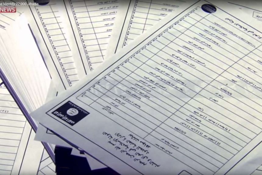 Documents identifying ISIS supporters are seen in a video still on March 10, 2016.