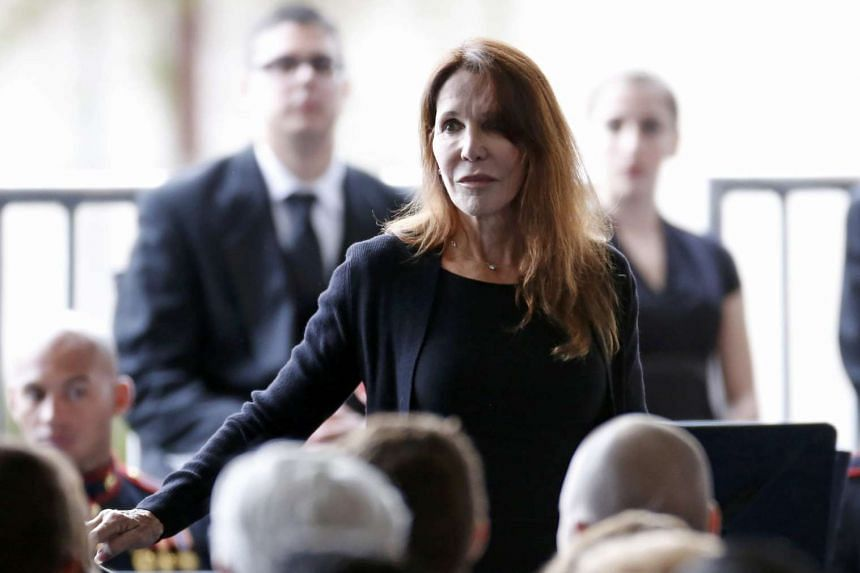 Patti Davis, daughter of Nancy Reagan, returns to her seat after speaking at her mothers funeral.