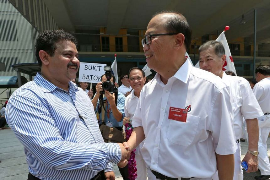 Independent candidate Samir Salim Neji (left) greeting David Ong at the Keming Primary School nomination centre on Sept 1, 2015.