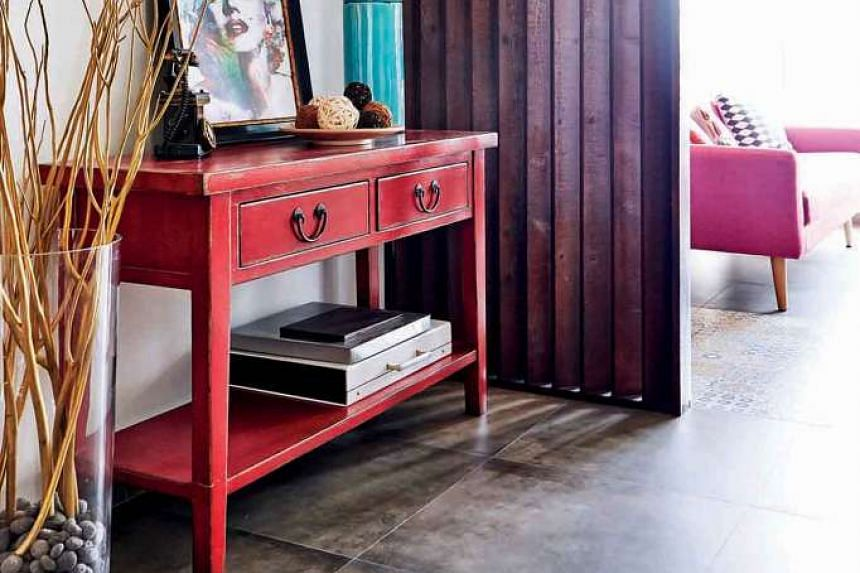A red sideboard anchors the space just after the main entrance