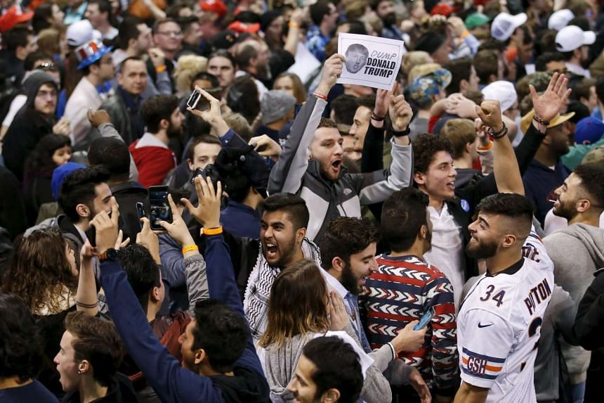 Demonstrators cheering after Republican presidential candidate Donald Trump cancelled his rally in Chicago on March 11.