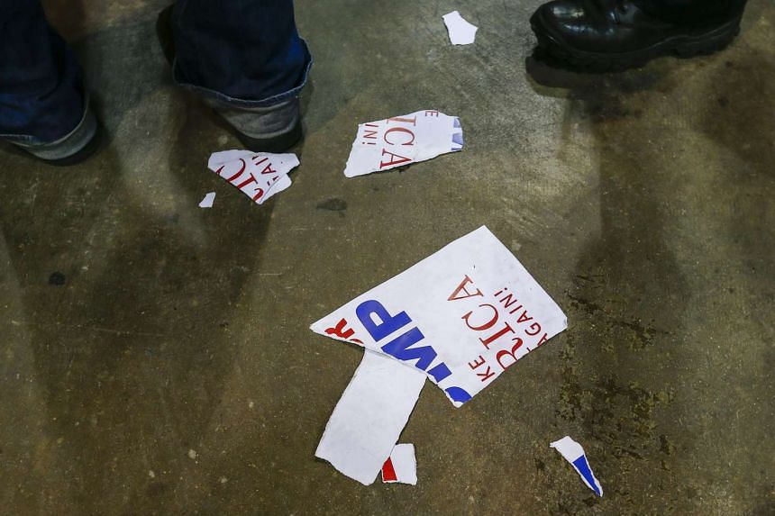 Tattered campaign signs lying on the floor after Donald Trump was forced to cancel a rally at the University of Illinois at Chicago Pavilion on March 11.
