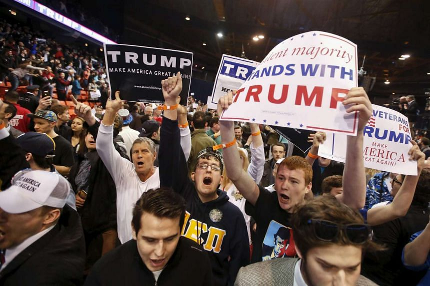 Trump supporters at the cancelled rally in Chicago on March 11.