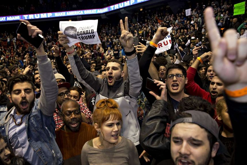 Demonstrators react after the cancellation of Trump's campaign event in Chicago, Illinois, on March 11, 2016.