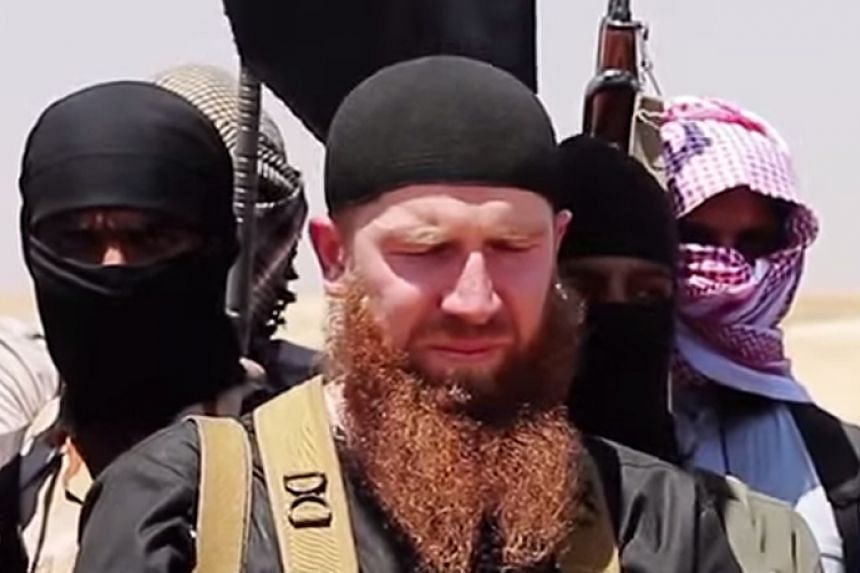 """Omar al-Shishani (centre) has been """"clinically dead"""" for several days after a US air strike in Syria, said a monitoring group."""
