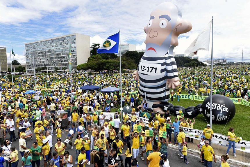 Opponents of the Brazilian government take part in a protest demanding President Dilma Rousseff's resignation on March 13, 2016 at the Esplanada dos Ministerios in Brasilia.