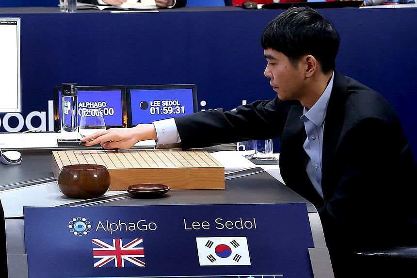 Mr Hassabis (far left), a London- born son of a Chinese- Singaporean mother and a father of Greek-Cypriot descent, is a modern-day polymath. South Korean grandmaster Lee (left) starting Match 3 of the Google DeepMind Challenge Match in Go yesterday i