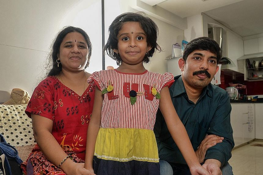 Seven-year-old Videm Sree Vainavi is seen here with her parents - permanent residents Sumalatha Videm and Videm Nagender - who tried unsuccessfully to get her a place at a local school. The family from India is finding it difficult to afford the $1,1