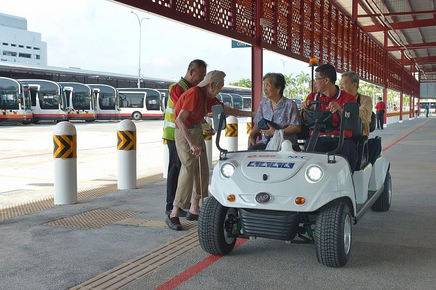 Senior citizens trying out the buggy service at the Woodlands Temporary Bus Interchange on its first day of operations yesterday. The interchange will be in service until 2019, while the Woodlands Regional Interchange undergoes upgrading and an under