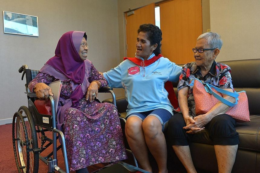 As a volunteer in the Neighbours for Active Living programme, Ms Nekmah Mahadi (centre) helps and keeps an eye on her elderly neighbours, Madam Zainab Abdullah (left), 73, and Madam Tan Ah Pong, 88.
