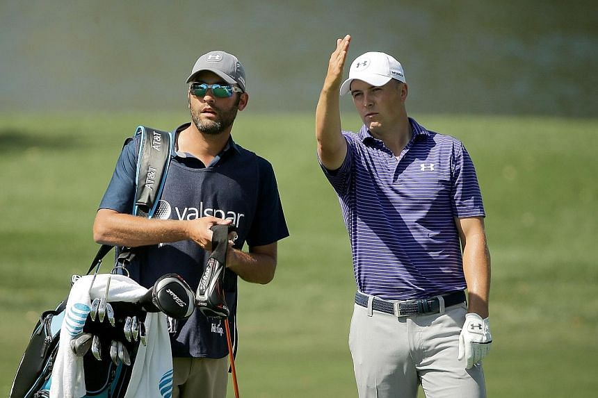 World No. 1 Jordan Spieth (right) discussing a hole with his caddie Michael Greller at the Valspar Championship on Friday. The American was relieved to make the cut after a poor start, but remains seven strokes behind the leaders.