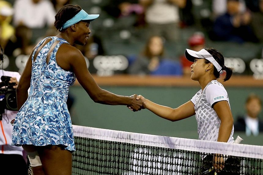 Venus Williams (left) shaking hands with Japanese qualifier Kurumi Nara after her first-round loss on Friday. The American had returned to play in the Indian Wells tournament after 15 years.