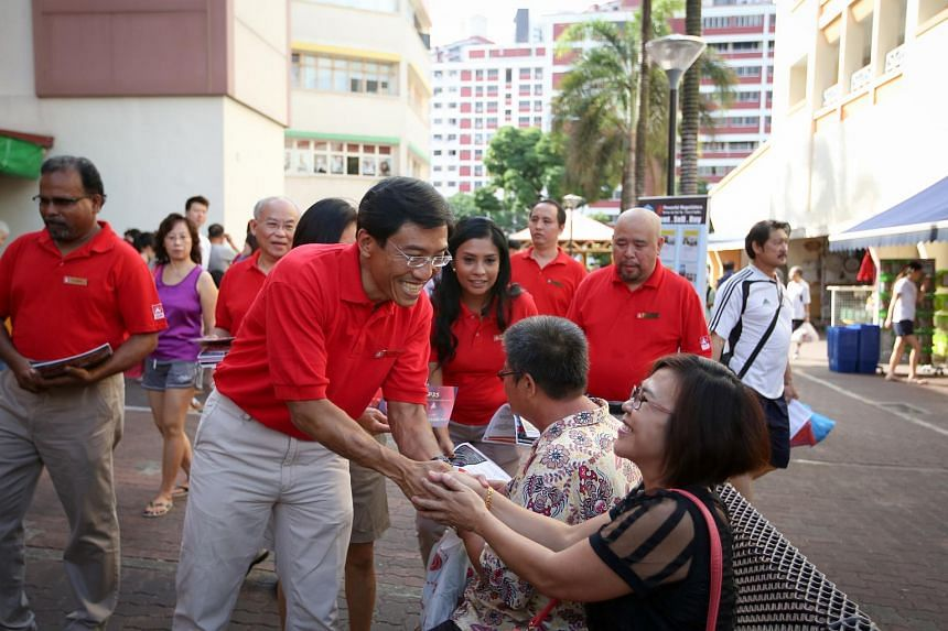 Singapore Democratic Party chief Chee Soon Juan shakes hands with a resident during the party's walkabout in Bukit Batok.
