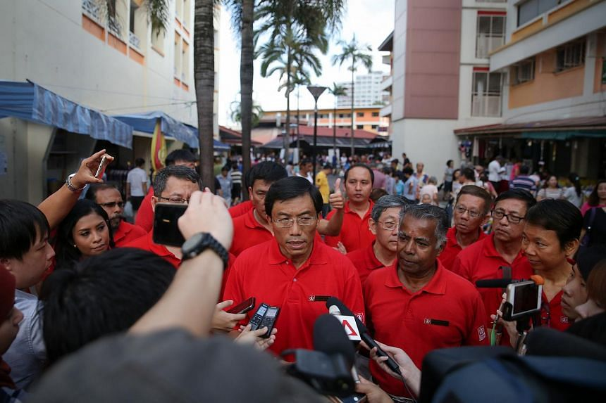 Singapore Democratic Party chief Chee Soon Juan addresses the media before the party's walkabout in Bukit Batok.