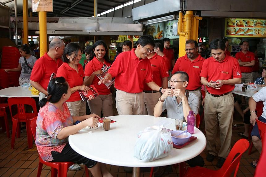 Dr Chee and the rest of his party members greeting residents in Bukit Batok.
