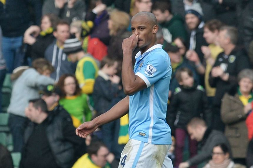 Manchester City's Vincent Kompany looks dejected after the game.