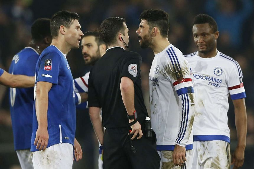 Chelsea's Diego Costa is sent off by referee Michael Oliver.