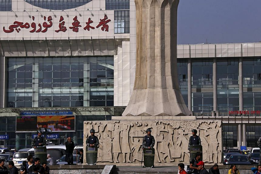 Armed police guard the entrance of the South Railway Station, where three people were killed and 79 wounded in a bomb and knife attack, in Urumqi, Xinjiang Uighur Autonomous region.