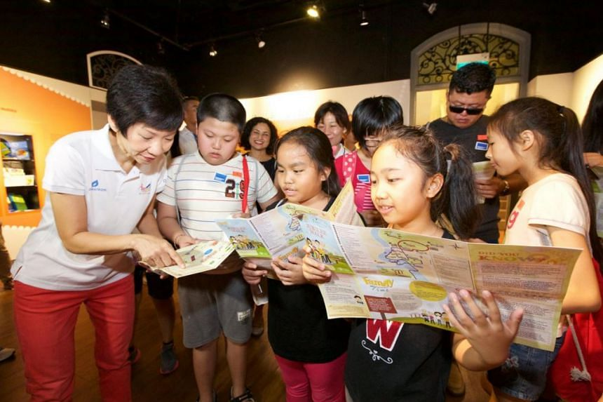 Minister for Culture, Community and Youth Grace Fu (left) interacting with children at the launch of HeritageCares on March 13, 2016.