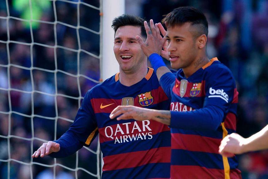 Messi (left) and Barcelona's Brazilian forward Neymar celebrate an Getafe own goal.