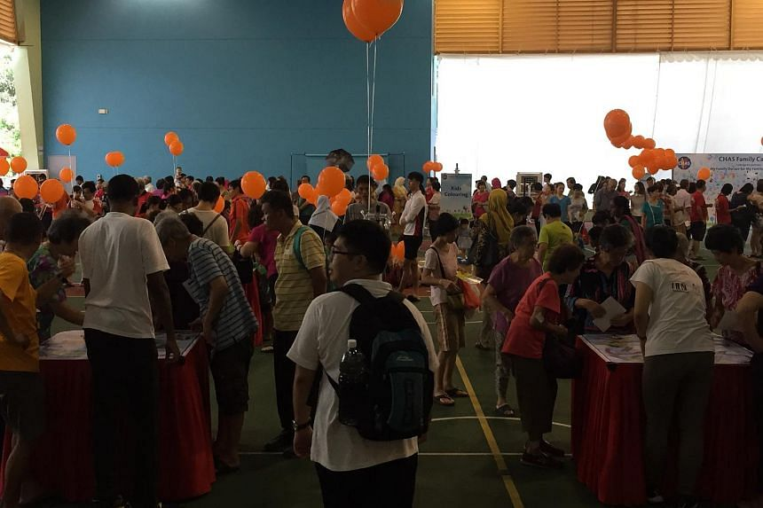 Residents at the Chas Family Carnival in Choa Chu Kang Community Club on Sunday morning.