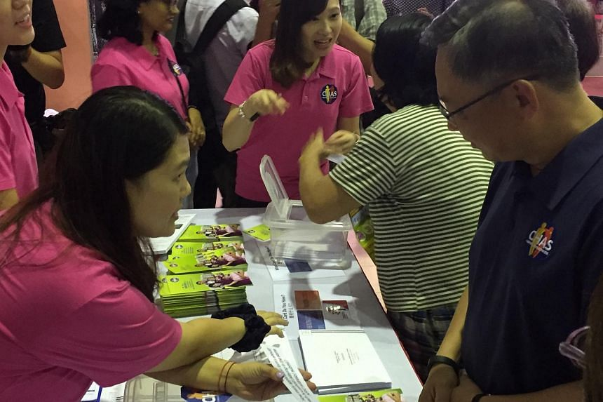 Health Minister Gan Kim Yong being quizzed at a booth at the Chas Family Carnival at Choa Chu Kang Community Club on Sunday morning.