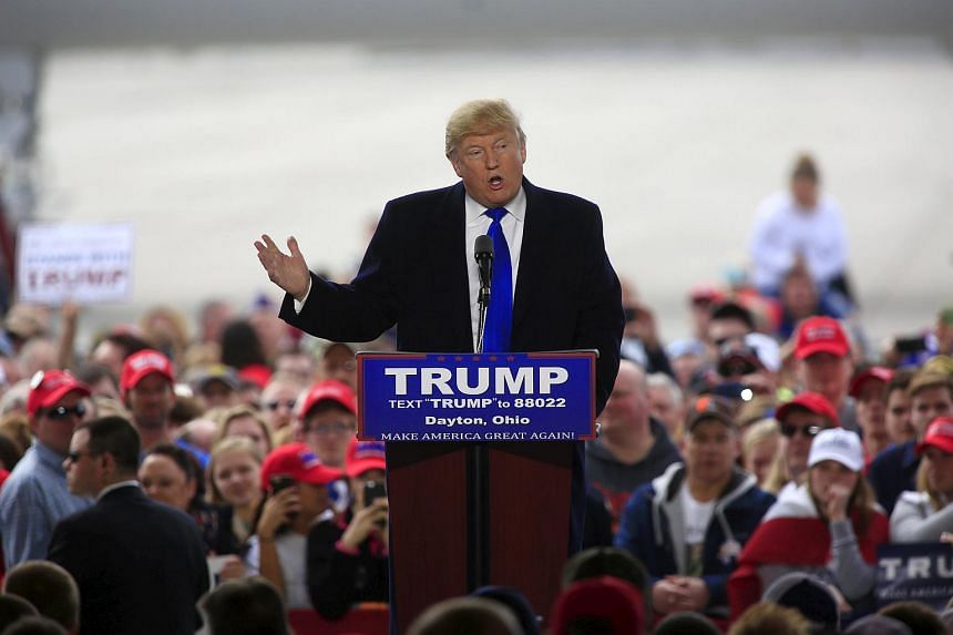 US Republican presidential candidate Donald Trump speaks at Dayton International Airport in Dayton, Ohio, on March 12, 2016.