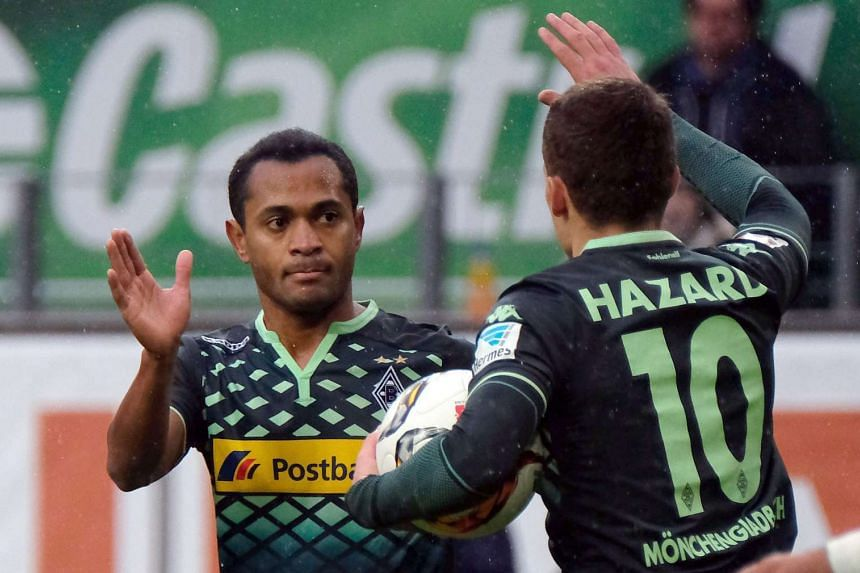 Raffael (above left, in a file photo) curled his shot in from 30m after the keeper sent the ball straight into his path.