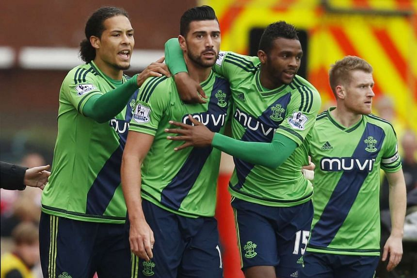 Graziano Pelle celebrates with team mates after scoring the first goal for Southampton.