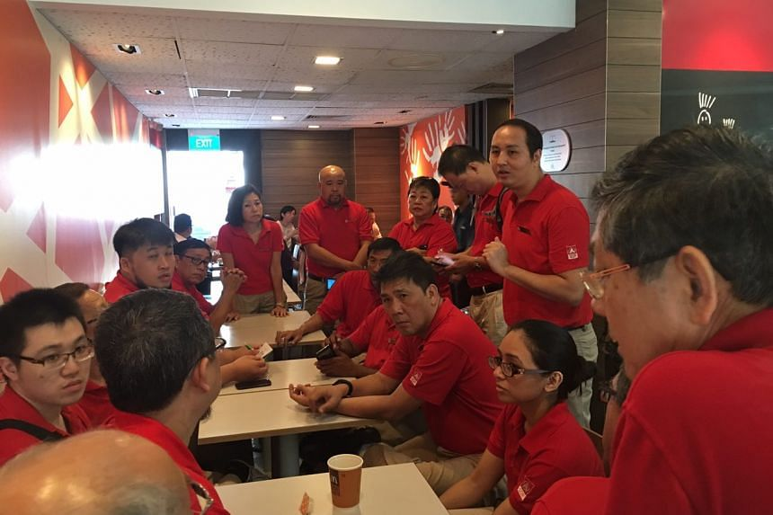 SDP members attend a briefing in a McDonald's outlet at Bukit Batok West Avenue 6 before their walkabout on March 13, 2016.