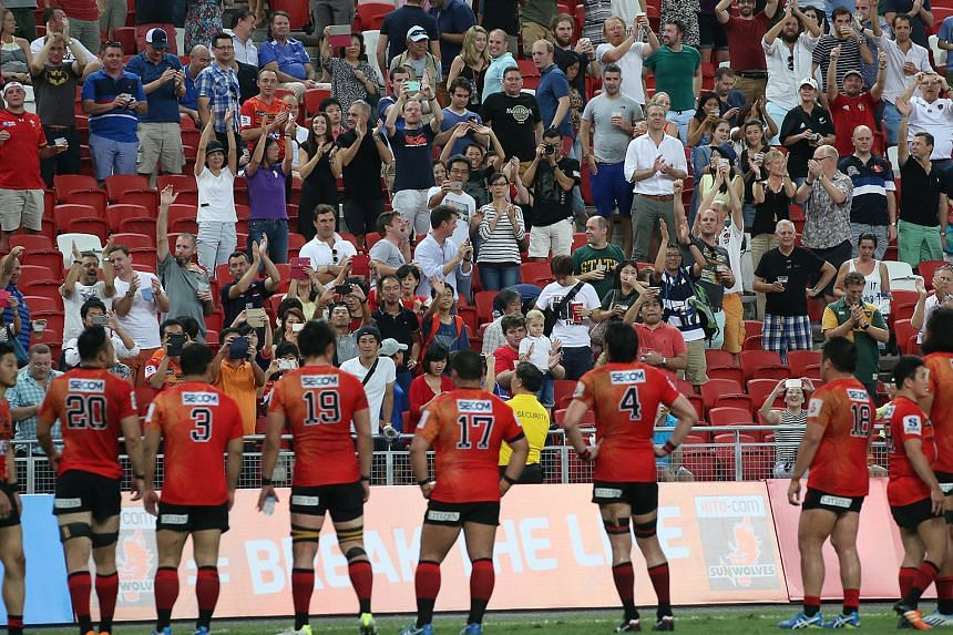 The beaten Sunwolves, co-based in Japan and Singapore, being applauded by the crowd at the National Stadium after their 31-32 loss to the Cheetahs.