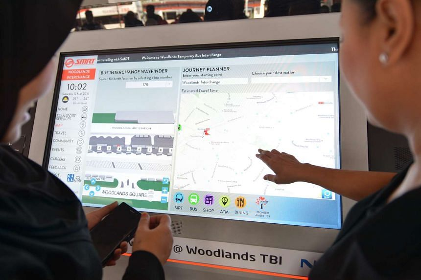 An electronic panel which displays information on available parking bays for bus drivers, and an interactive bus guide (above) for users to plan their journeys at the Woodlands Temporary Bus Interchange.