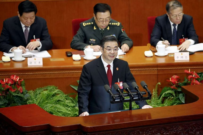 President of China's Supreme People's Court Zhou Qiang gives a speech at the National People's Congress (NPC) in Beijing, China, on March 13, 2016.