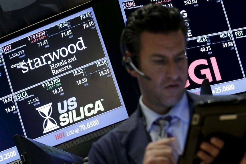 Traders at where the stock for Starwood Hotels & Resorts Worldwide Inc. is traded in the New York Stock Exchange.