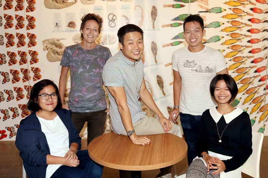 (From left) Specialist associate Chen Mingshi, conservator Kate Pocklington, curators Marcus Chua (mammals and birds) and Foo Maosheng (cryogenic collection), and specialist associate Iffah Iesa were involved in the preservation of the whale skeleton