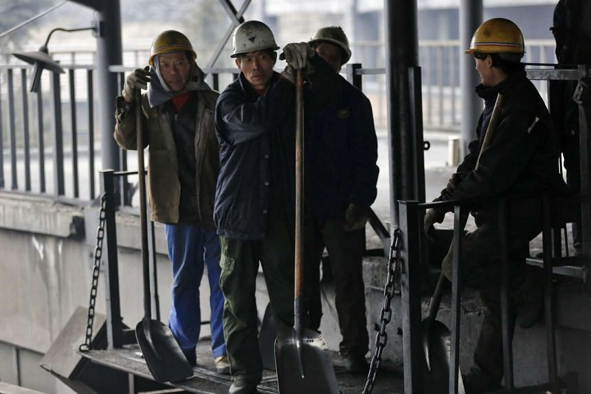 Chinese workers working on a transport line in a coal mine in the Fangshan district on the outskirts of Beijing, China on March 4, 2016.