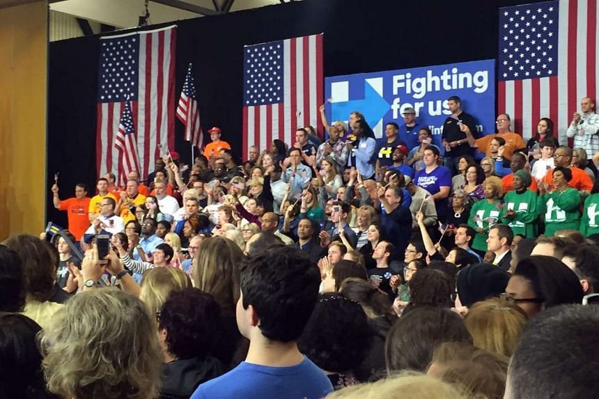 Supporters await the appearance of Democratic presidential candidate Hillary Clinton at a rally at Cuyahoga Community College in Cleveland, Ohio.