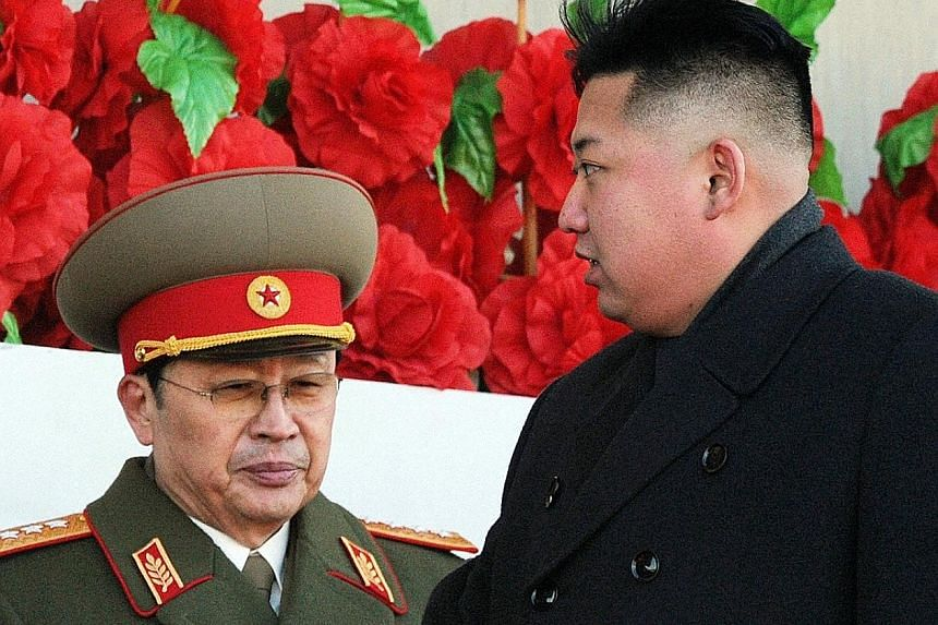 """North Korean leader Mr Kim (right) with Jang in 2012, before he fell from power. A new biography describes Jang as virtually the only one """"who could have helped the country introduce reform and openness""""."""