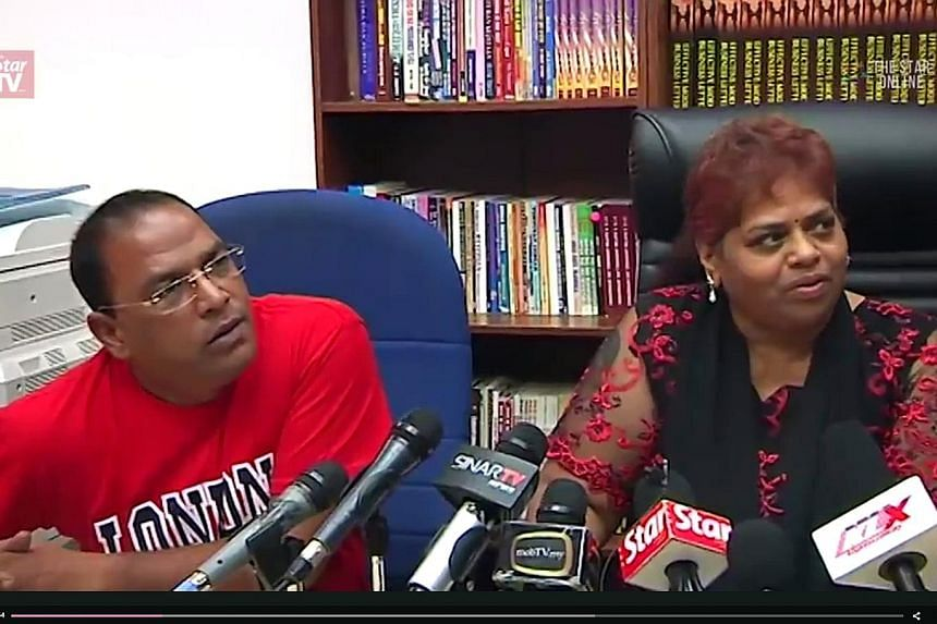 Ms Selvi with Mr Ramesh at the news conference on Saturday. She apologised for linking Mr Najib to her husband's death, but insisted her husband's allegations about the PM's involvement in the murder were true.