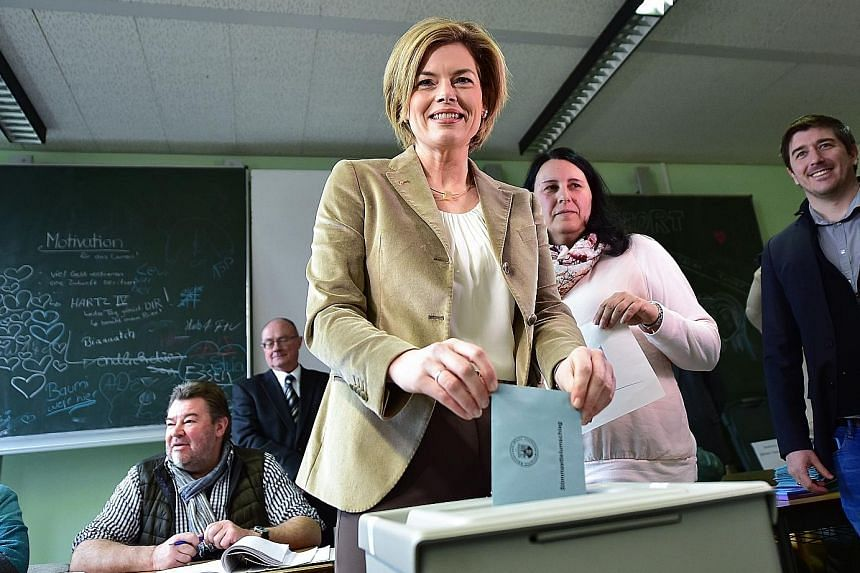 CDU candidate Julia Kloeckner for Rhineland-Palatinate, which is becoming the pivotal swing state, casting her ballot yesterday.
