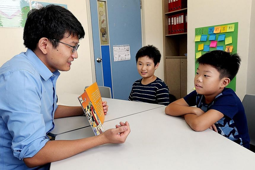 Teacher Li Dong with (from left) Lee Jia Le, 10, and Ng Jun Rui Elgin, 10, during a Chinese literacy class at DAS.